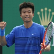 Di Wu of China celebrates after defeating Danai Udomchoke of Thailand at the Asia-Pacific Australian Open Wildcard Play-off; Getty Images