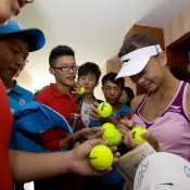 Asia-Pacific Australian Open Wildcard Play-off women's winner Yuxuan Zhang of China signs autographs for tennis fans in Nanjing, China; Getty Images