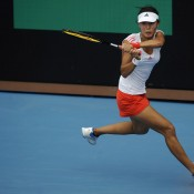 Qiang Wang of China plays a backhand during the Asia-Pacific Australian Open Wildcard Play-off women's singles final in Nanjing, China; Getty Images