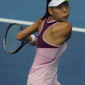 Yuxuan Zhang of China returns a shot to Qiang Wang of China during the women's singles final of the Asia-Pacific Australian Open Wildcard Play-off in Nanjing, China; Getty Images