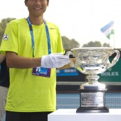 Di Wu of China holds the Norman Brookes Challenge Cup, awarded to the men's winner of the Australian Open; Getty Images