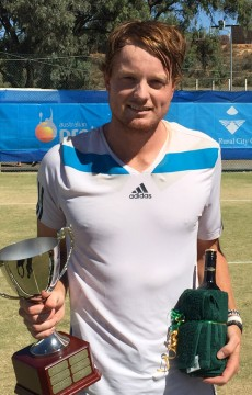 Matthew Barton poses with his trophy after defeating Harry Bourchier in the men's singles final of the Mildura Grand International