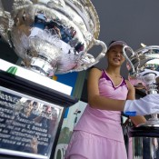 Zhang Yuxuan of China holds the Daphne Akhurst Memorial Cup as she celebrates defeating Wang Qiang of China during the women's singles final of the Asia-Pacific Australian Open Wildcard Play-off at Nanjing Sport Institute on October 21, 2012 in Nanjing, China; Getty Images
