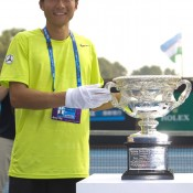 Wu Di of China holds the Norman Brookes Challenge Cup as he celebrates defeating Danai Udomchoke of Thailand during the men's singles final of the Asia-Pacific Australian Open Wildcard Play-off at Nanjing Sport Institute on October 21, 2012 in Nanjing, China; Getty Images