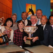 Ken Rosewall (front row centre), his wife Wilma (on his left), Tennis Australia CEO Steve Wood (back row right) and Japanese tennis officials pose with the Australian Open trophies in Tokyo; Tennis Australia