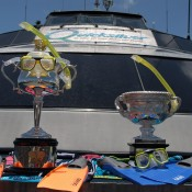 The Norman Brookes Challenge Cup (R) and the Daphne Akhurst Memorial Cup all kitted up aboard the Quicksilver high-speed wave-piercing catamaran for their Great Barrier Reef tour; Tennis Australia