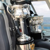 The Daphne Akhurst Memorial Cup (foreground) and the Norman Brookes Challenge Cup fly via helicopter for their tour of the Great Barrier Reef off the coast of Port Douglas, Queensland; Tennis Australia