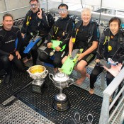 The Australian Open trophies and scuba divers aboard the Quicksilver high-speed wave-piercing catamaran for a tour of the Great Barrier Reef; Tennis Australia