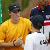 Harry Bouchier (L) shakes hands with the United States' Stefan Kozlov after winning their singles rubber in the Australia v United States semifinal at the Junior Davis Cup world finals in Barcelona; photo Srdjan Stevanovic