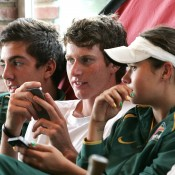 (L-R) Thanasi Kokkinakis, Harry Bouchier and Isabelle Wallace relax during the Junior Davis and Fed Cup world finals in Barcelona; photo Srdjan Stevanovic