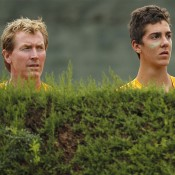 Australia Junior Davis Cup captain Mark Woodforde (L) and Thanasi Kokkinakis keep an intent eye on the action at the world finals in Barcelona; photos Srdjan Stevanovic