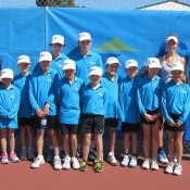 Ashleigh Barty (L) and Olivia Rogowska (second from right, back row) with tournament staff at the Esperance Pro Tour event; Tennis Australia