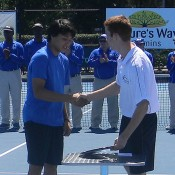 Akira Santillan is presented with the trophy after winning the boys' event at the 2012 Sydney ITF Junior International; Tennis Australia