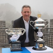 Tennis Australia CEO Steve Wood poses with the Australian Open men's and women's singles trophies in China; Getty Images