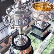 The Daphne Akhurst Memorial Cup and the Norman Brookes Challenge Cup on display in Tokyo as part of the AO Trophy Tour; Keith Tsuji