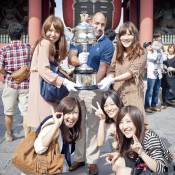 Fans pose with the Daphne Akhust Memorial Cup in Tokyo as part of the AO Trophy Tour; Keith Tsuji
