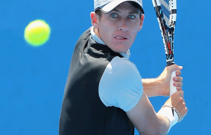 MELBOURNE, AUSTRALIA - DECEMBER 15:  Gavin Van Peperzeel plays a backhand in his first round match against Mitchell Robins of Australia during the 2015 Australian Open play off at Melbourne Park on December 15, 2014 in Melbourne, Australia.  (Photo by Robert Prezioso/Getty Images)