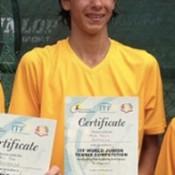 Alexei Popyrin representing Australia at the ITF World Junior Tennis competition in 2013