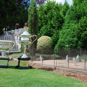 The Australian Open trophies at the miniature tennis court at Cockington Green in Canberra; Tennis Australia