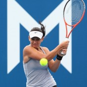 Casey Dellacqua returns a shot in her first round match against Galina Voskoboeva at the 2012 Hobart International, which she won in straight sets for her first win of the season; Getty Images