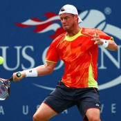 Lleyton Hewitt returns a shot during his third round match against David Ferrer on Louis Armstrong Stadium at the 2012 US Open; Getty Images