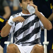 Marinko Matosevic takes a drinks break on an oppressively humid opening night of the US Open, on which he took on 12th seed Marin Cilic of Croatia on Court 17 at Flushing Meadows in New York; Getty Images