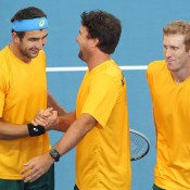 Australian Davis Cup coach Pat Rafter congratulates Marinko Matosevic after winning his doubles match with Chris Guccione over the Koreans during Day 2 of the Asia Oceania Zone I Group second round tie in Brisbane, Australia. It was Matosevic's first live Davis Cup rubber win; Getty Images