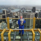 Ken Rosewall poses with the Australian Open men's singles trophy during the Australian Open Trophy Tour at Sky Walk, Sydney Tower in Sydney, Australia; Getty Images