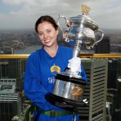 Tennis NSW's Briony Craber holds the Daphne Akhurst Memorial Cup during the Australian Open Trophy Tour's visit to Sydney Tower's Sky Walk; Tennis Australia