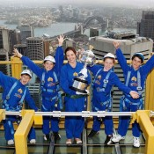 Tennis NSW's Briony Craber (centre) and (L-R) Tristan Dardis, Kate Stanbridge, Ella Lanigan and Harrison Garrett from Mosman Lawn Tennis Club pose with the Daphne Akhurst Memorial Cup during the Australian Open Trophy Tour at Sky Walk, Sydney Tower in Sydney, Australia; Tennis Australia