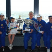 Ken Rosewall (centre) and (L-R) Kate Stanbridge, Tristan Dardis, Ella Lanigan and Harrison Garrett from Mosman Lawn Tennis Club pose with the Australian Open trophies at Sky Walk, Sydney Tower in Sydney, Australia; Tennis Australia