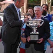 Ken Rosewall holds the Norman Brookes Challenge Cup as he is interviewed by Seven Sunrise's Mark Beretta in Sydney; Tennis Australia