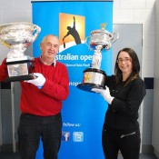 Tennis Tasmania vice-president Phil Bowden (L) and Tasmanian Minister for Sport and Recreation Michelle O'Byrne pose with the Australian Open trophies at Trevallyn Tennis Club in Launceston, Tasmania; Tennis Australia