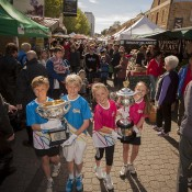 (L-R) Andrew Bourke, Jordan Petryk, Charlotte Ingram and Coral Lee Hutchins walk the Australian Open trophies through Hobart's Salamanca Markets; Tennis Australia