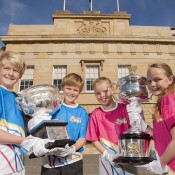 (L-R) Jordan Petryk, Andrew Bourke, Charlotte Ingram and Coral Lee Hutchins pose with the Australian Open trophies outside Parliament House in Hobart; Tennis Australia