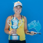 Abbie Myers poses with the winner's trophy after claiming the Optus 18s Australian Championships girls' title; Matthew Johnson