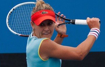 Monique Adamczak on her way to defeating Viktorija Rajicic in the quarterfinals of the Australian Open 2013 Play-off at Melbourne Park; Matt Johnson