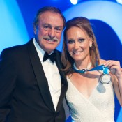 Sam Stosur (R) poses with the Newcombe Medal alongside presenter John Newcombe, after winning the award for the third consecutive year for Australia's most outstanding elite tennis player; Bek Johnson