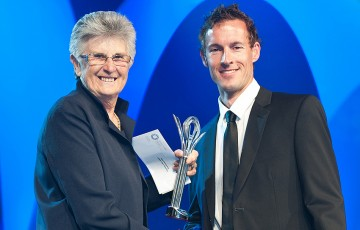 Glen Flindell (R) accepts the award for Most Outstanding Athlete with a Disability from Judy Dalton at the 2012 Newcombe Medal Australian Tennis Awards; Bek Johnson