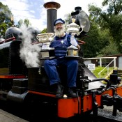 Puffing Billy train driver Gary poses with the Australian Open trophies as part of the Australian Open trophy tour's stop in Belgrave, Victoria; Bek Johnson