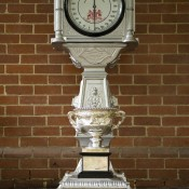 The Norman Brookes Challenge Cup poses on the cargo and luggage scales at Belgrave, Victoria as part of the Australian Open Trophy Tour's stop at the Puffing Billy steam train; Bek Johnson
