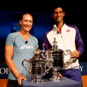 Novak Djokovic (R) and Sam Stosur pose with the winners trophies during the draw ceremony prior to the start of the 2012 US Open in New York City; Getty Images for USTA