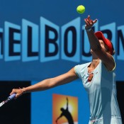 Monique Adamczak of Australia serves during her matach against Dinah Pfizenmaier of Germany during Australian Open qualifying at Melbourne Park on January 10, 2013 in Melbourne, Australia; Getty Images