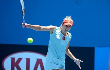 Monique Adamczak of Australia hits a backhand during her opening match at Australian open 2013 qualifying