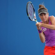 Bojana Bobusic of Australia plays a backhand in her match against Alize Cornet of France during day two of the Brisbane International at Pat Rafter Arena on December 31, 2012 in Brisbane, Australia; Getty Images