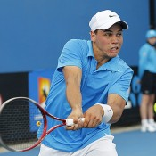 Aussie Alex Bolt plays a backhand in his match against Frenchman Florent Serra on Day 2 of Australian Open 2013 Qualifying.