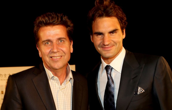 ATP Executive Chairman & President Brad Drewett poses for photographers with Roger Federer of Switzerland during a reception for the Shanghai Rolex Masters at the Hilton Hotel on October 8, 2012 in Shanghai, China; Getty Images
