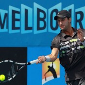 Adam Feeney of Australia plays a forehand during his match against Cedrik-Marcel Stebe of Germany during Australian Open qualifying at Melbourne Park on January 11, 2013 in Melbourne, Australia; Getty Images