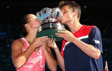 Australian wildcard pairing Jarmila Gajdosova and Matthew Ebden celebrate their victory in the mixed doubles championship at Australian Open 2013; Getty Images
