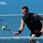 Australia's Sam Groth volleys during his match on day 1 of Australian Open 2013 qualifying